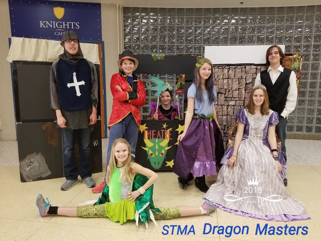 Picture of the Destination Imagination team.  Seven students dressed in medieval clothing with a puppet theater and dragon.