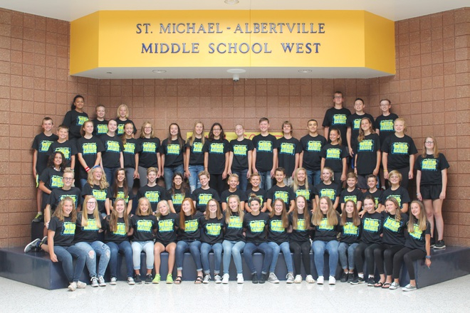 Picture of the Middle School West WEB Leaders.  Students lined up in two rows in the entry under the St. Michael- Albertville