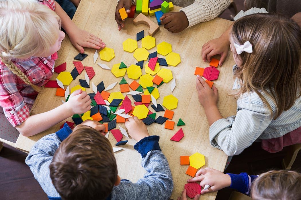 Pre kindergarten children playing with shapes