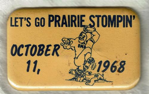 Homecoming Button from October 11, 1968 that says Let's Go Prairie Stompin' with a football player stepping on another